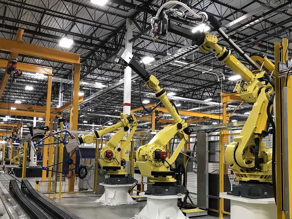 Robots welding metal
